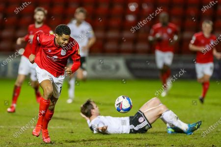 Crewe Alexandra forward Mikael Mandron (12) runs away with the ball leaving Accrington Stanley defender Mark Hughes (3) on the floor during the EFL Sky Bet League 1 match between Crewe Alexandra and Accrington Stanley at Alexandra Stadium, Crewe