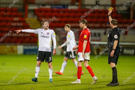 Accrington Stanley defender Mark Hughes (3) receives a yellow card from The Referee Brett Huxtable during the EFL Sky Bet League 1 match between Crewe Alexandra and Accrington Stanley at Alexandra Stadium, Crewe