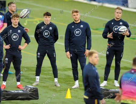(L to R) Darcy Graham, Jamie Dobie, Chris Harris and Duhan van der Merwe - Scotland players listen to the player instructions.