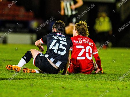 Joe Adams (45) Grimsby Town and Sam Matthews (20) of Crawley Town take a breather during the EFL Sky Bet League 2 match between Grimsby Town FC and Crawley Town at Blundell Park, Grimsby