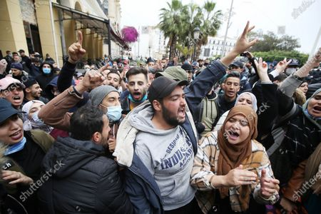 """Stock Photo of Students chant slogans during a demonstration in the center of the Algerian capital, Algiers, on February 23, 2021, the day after the second anniversary of the """"Hirak"""" protest movement. - The 'Hirak' protest movement in April 2019 forced longtime President Abdelaziz Bouteflika to resign (Photo by APP/NurPhoto)"""