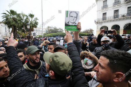 """Students chant slogans during a demonstration in the center of the Algerian capital, Algiers, on February 23, 2021, the day after the second anniversary of the """"Hirak"""" protest movement. - The 'Hirak' protest movement in April 2019 forced longtime President Abdelaziz Bouteflika to resign (Photo by APP/NurPhoto)"""