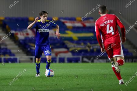 AFC Wimbledon midfielder George Dobson (24) dribbling and about to take on Gillingham FC midfielder Stuart O'Keefe (4)during the EFL Sky Bet League 1 match between AFC Wimbledon and Gillingham at Plough Lane, London