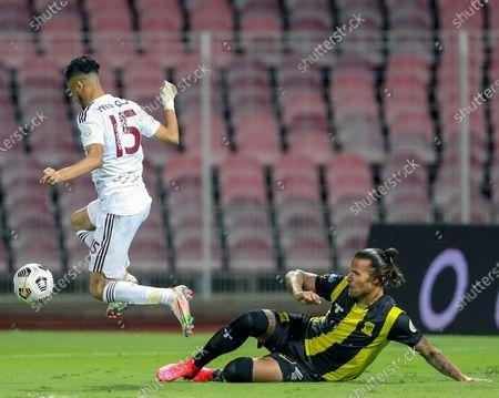 Al-Ittihad's player Aleksandar Prijovic (R) in action against Al-Faisaly's Ahmed Ashraf (L) during the Saudi Professional League soccer match between Al-Ittihad and Al-Faisaly at King Abdulaziz Stadium, in Mecca, Saudi Arabia, 23 February 2021.