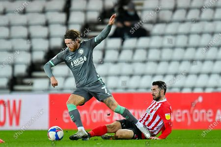 Conor McLaughlin (#2) of Sunderland AFC tackles Wes Burns (#7) of Fleetwood Town FC during the EFL Sky Bet League 1 match between Sunderland AFC and Fleetwood Town at the Stadium Of Light, Sunderland