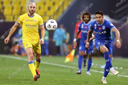Al-Nassr's player Nordin Amrabat (L) in action against Al-Hilal's Salem Al-Dawsari (R) during the Saudi Professional League soccer match between Al-Nassr and Al-Hilal at King Saud University Stadium, in Riyadh, Saudi Arabia, 23 February 2021.