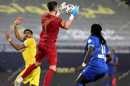 Al-Nassr's goalkeeper Brad Jones (C) in action against Al-Hilal's Bafetimbi Gomis (R) during the Saudi Professional League soccer match between Al-Nassr and Al-Hilal at King Saud University Stadium, in Riyadh, Saudi Arabia, 23 February 2021.