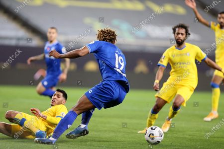 Al-Nassr's player Sultan Al-Ghannam (L) in action against Al-Hilal's Andre Carrillo (2-L) during the Saudi Professional League soccer match between Al-Nassr and Al-Hilal at King Saud University Stadium, in Riyadh, Saudi Arabia, 23 February 2021.