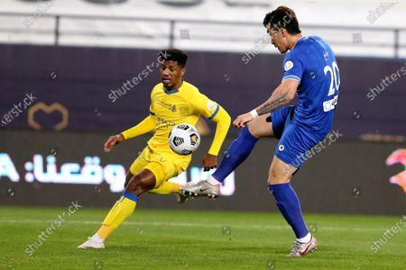 Stock Photo of Al-Nassr's player Raed Al-Ghamdi (L) in action against Al-Hilal's Hyun Soo Jang (R) during the Saudi Professional League soccer match between Al-Nassr and Al-Hilal at King Saud University Stadium, in Riyadh, Saudi Arabia, 23 February 2021.