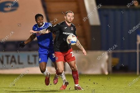 Lewis Page (20) of Exeter City controls the ball challenged by Colchester United's Michael Folivi (39) during the EFL Sky Bet League 2 match between Colchester United and Exeter City at the JobServe Community Stadium, Colchester