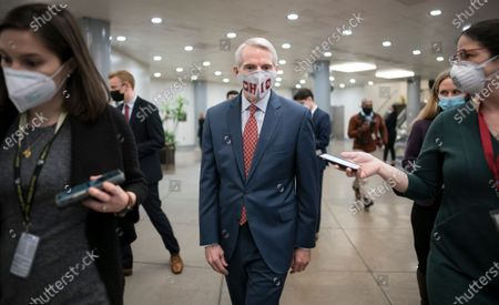 Sen. Rob Portman, R-Ohio, talks to reporters as senators arrive to vote on President Joe Biden's nominee for United Nation's ambassador, Linda Thomas-Greenfield, at the Capitol in Washington