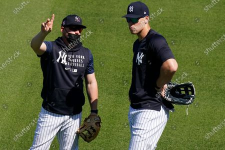 New York Yankees' Aaron Judge, right, talks to a teammate during a spring training baseball workout, in Tampa, Fla
