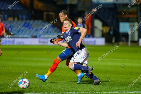 Ben Thompson (8) of Millwall holds off Tom Ince (39) of Luton Town during the EFL Sky Bet Championship match between Luton Town and Millwall at Kenilworth Road, Luton