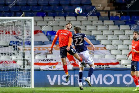 Martin Cranie (2) of Luton Town and Jon Dadi Bodvarsson (22) of Millwall clash in the air during the EFL Sky Bet Championship match between Luton Town and Millwall at Kenilworth Road, Luton