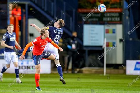 Stock Picture of Kiernan Dewsbury-Hall (22) of Luton Town and Ben Thompson (8) of Millwall clash in the air during the EFL Sky Bet Championship match between Luton Town and Millwall at Kenilworth Road, Luton