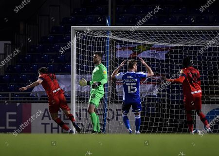 Scott Wootton of Wigan Athletic scores his sides second goal of the game