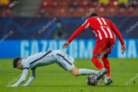 Chelsea's Jorginho, left, fights for the ball with Atletico Madrid's Thomas Lemar during the Champions League, round of 16, first leg soccer match between Atletico Madrid and Chelsea at the National Arena stadium in Bucharest, Romania