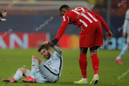 Stock Image of Chelsea's Christian Pulisic, left, and Atletico Madrid's Moussa Dembele during the Champions League, round of 16, first leg soccer match between Atletico Madrid and Chelsea at the National Arena stadium in Bucharest, Romania