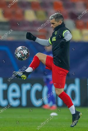 Atletico Madrid's Lucas Torreira juggles with the ball during the Champions League, round of 16, first leg soccer match between Atletico Madrid and Chelsea at the National Arena stadium in Bucharest, Romania