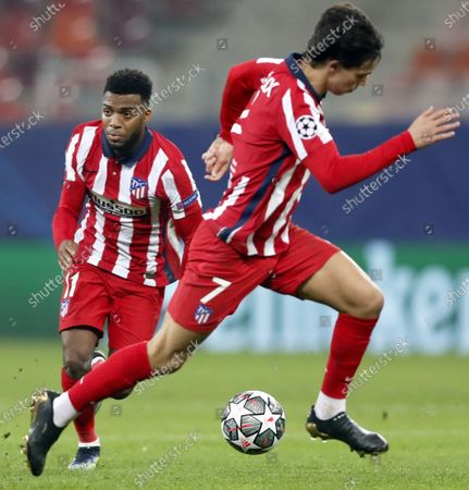 Atletico's Joao Felix (R) and Thomas Lemar (L) in action during the UEFA Champions League round of 16, first leg soccer match between Atletico Madrid and Chelsea FC in Bucharest, Romania, 23 February 2021.