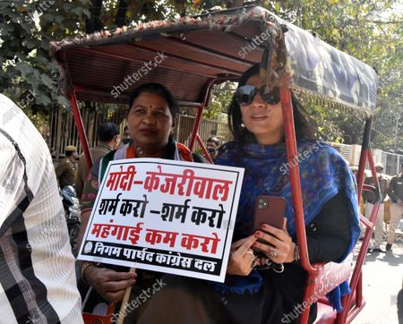 Stock Image of Congress Municipal Councillor's be going by cycling riksha to Civic Center for February Monthly house to express their protest towards rising Petrol Diesel Prices in Delhi, at Gandhi market golchakkar , Back gate of Zakir Hussain College on February 23, 2021 in New Delhi, India.