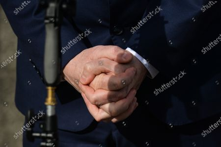 Hands of Michael McGrath, Irish Minister for Public Expenditure and Reform, during media interview outside Government Buildings in Dublin before the Cabinet meeting. This evening, Taoiseach Micheal Martin announced the extension of Ireland's Level 5 restrictions to April 5th.The revised Living with Covid plan announced by the Taoiseach includes the gradual reopening of schools and childcare.On Tuesday, February 23, 2021, in Dublin, Ireland.