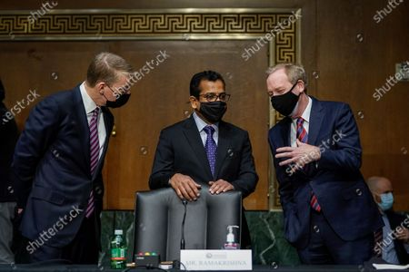 FireEye CEO Kevin Mandia, SolarWinds CEO Sudhakar Ramakrishna and Microsoft President Brad Smith talk before a Senate Intelligence Committee hearing on Capitol Hill on in Washington