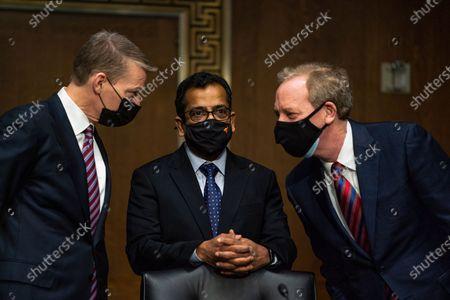 FireEye CEO Kevin Mandia, SolarWinds CEO Sudhakar Ramakrishna and Microsoft President Brad Smith talk to each other before a Senate Intelligence Committee hearing on Capitol Hill on in Washington