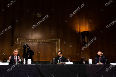 FireEye CEO Kevin Mandia, SolarWinds CEO Sudhakar Ramakrishna and Microsoft President Brad Smith testify before a Senate Intelligence Committee hearing on Capitol Hill on in Washington