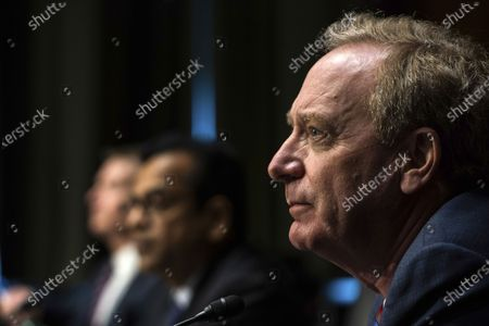Microsoft President Brad Smith listens during a Senate Intelligence Committee hearing on Capitol Hill on in Washington