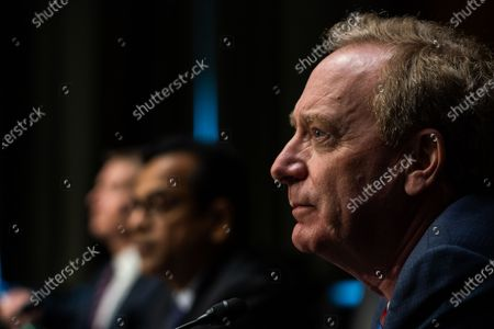 Stock Picture of WASHINGTON, DC : Microsoft President Brad Smith listens during the Senate Intelligence Committee hearing on Capitol Hill in Washington, DC. February 23, 2021.
