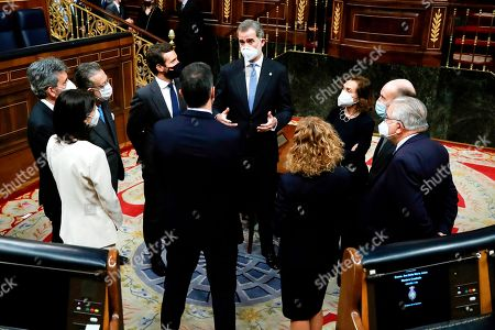 King Felipe VI, the first vice president of the Government, Carmen Calvo (3rd), one of the fathers of the Constitution, Miquel Roca (2nd), the president of the Constitutional Court, Juan Jose Gonzalez Rivas (r) the president of Congress, Meritxell Batet (4th), the President of the Government, Pedro Sanchez, the President of the Senate, Pilar Llop (2l), the President of the Supreme Court, Carlos Lesmes (1), one of the fathers of the Constitution, Miguel Herrero and Rodriguez de Minon (3l) and the President of the Popular Party, Pablo Casado (4l)