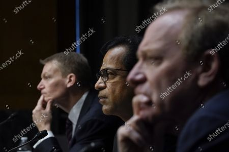 (L-R) FireEye CEO Kevin Mandia, SolarWinds CEO Sudhakar Ramakrishna and Microsoft President Brad Smith testify during a Senate Intelligence Committee hearingon Capitol Hill in Washington, DC on Tuesday, February 23, 2021. The hearing focused on the 2020 cyberattack that resulted in a series of data breaches within several agencies and departments of the U.S. federal government.