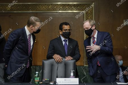 (L-R) FireEye CEO Kevin Mandia, SolarWinds CEO Sudhakar Ramakrishna and Microsoft President Brad Smith talk with each other before the start of a Senate Intelligence Committee hearing on Capitol Hill in Washington, DC on Tuesday, February 23, 2021. The hearing focused on the 2020 cyberattack that resulted in a series of data breaches within several agencies and departments of the U.S. federal government.
