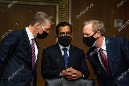 Stock Image of FireEye CEO Kevin Mandia, SolarWinds CEO Sudhakar Ramakrishna and Microsoft President Brad Smith speak with each other before the start of a Senate Intelligence Committee hearing on Capitol Hill in Washington, DC on Tuesday, February 23, 2021. The hearing focused on the 2020 cyberattack that resulted in a series of data breaches within several agencies and departments of the U.S. federal government.