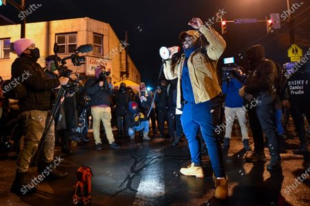 Anthony Hall speaks to a crowd gathered at the site of Daniel Prude's encounter with police officers in 2020, in Rochester, N.Y., . A grand jury voted not to charge officers shown on body camera video holding Prude down naked and handcuffed on a city street last winter until he stopped breathing. New York Attorney General Letitia James announced the decision Tuesday. The 41-year-old Black man's death last March sparked nightly protests in Rochester after the video was released nearly six months later