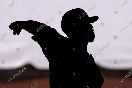 Stock Picture of San Diego Padres pitcher Chase Johnson throws during spring training baseball practice, in Peoria, Ariz