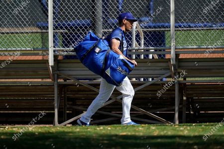 Stock Picture of Los Angeles Dodgers catcher Austin Barnes runs with all his catcher's gear to a practice field during a spring training baseball practice, in Phoenix