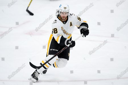 Pittsburgh Penguins defenseman Kris Letang (58) warms up before an NHL hockey game against the Washington Capitals, in Washington