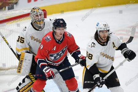 Pittsburgh Penguins goaltender Tristan Jarry (35) and defenseman Kris Letang (58) in action with Washington Capitals center Nicklas Backstrom (19) during the first period of an NHL hockey game, in Washington