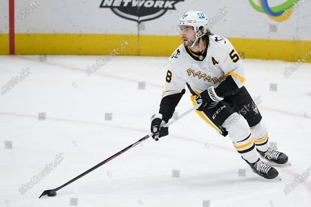 Pittsburgh Penguins defenseman Kris Letang (58) skates with the puck during the second period of an NHL hockey game against the Washington Capitals, in Washington