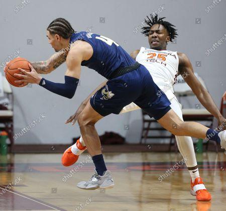 Virginia Tech's Justyn Mutts (25) draws a foul by Georgia Tech's Jordan Usher (4) during an NCAA college basketball game, in Blacksburg, Va