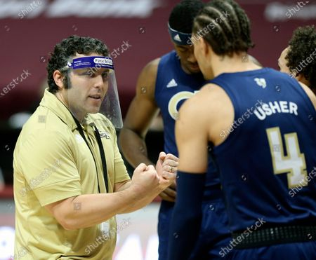 Georgia Tech head coach Josh Pastner speaks with Jordan Usher (4) during the first half of an NCAA college basketball game against Virginia Tech, in Blacksburg, Va