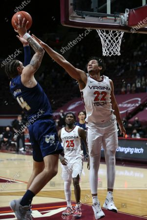 Georgia Tech's Jordan Usher (4) shoots over Virginia Tech's Keve Aluma (22) during the second half of an NCAA college basketball game, in Blacksburg, Va