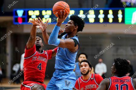 Villanova's Brandon Slater (3) goes up for a shot against St. John's Greg Williams Jr. (4) during the first half of an NCAA college basketball game, in Villanova, Pa