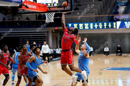 Stock Image of St. John's Greg Williams Jr. (4) goes up for shot past Villanova's Cole Swider (10) during the second half of an NCAA college basketball game, in Villanova, Pa