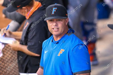 Stock Photo of Florida coach Kevin O'Sullivan stands in the dugout during the team's NCAA college baseball game against North Florida, in Jacksonville, Fla