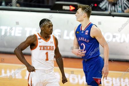 Texas guard Andrew Jones (1) celebrates in front of Kansas guard Christian Braun (2) after making a basket during the second half of an NCAA college basketball game, in Austin, Texas