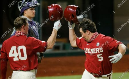Stock Picture of Oklahoma's Conor McKenna (5) is congratulated by Breydon Daniel (40) after hitting a solo home run in the fifth inning during an NCAA baseball game against Stephen F. Austin, in Arlington, Texas
