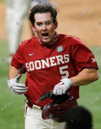 Oklahoma's Conor McKenna (5) celebrates hitting a solo home run in the fifth inning during an NCAA baseball game against Stephen F. Austin, in Arlington, Texas